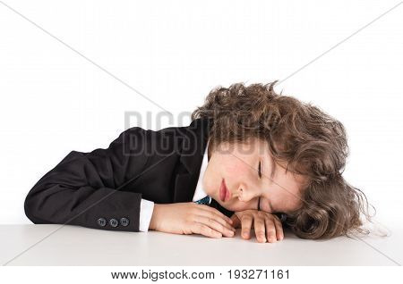 Cute Kinky Businessman Sleeping On The Table. Close-up. White Background.