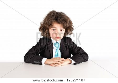 Cute Kinky Businessman Looking Sad In Front Of Him. Close-up. White Background.