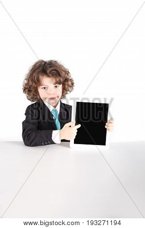 Little Curly-haired Businessman Sitting Half-turned, Points A Finger At The Tablet. Close-up. White