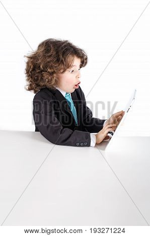 Cute Kinky Businessman Sitting Half-turned, Stares At The Tablet. Close-up. White Background.