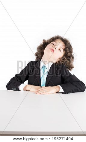 Little Curly Manager In A Business Suit Sitting At A Desk Sleeping, His Head Thrown Back. White Back