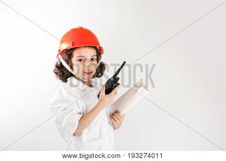 Young engineer said on the radio. Gray background.
