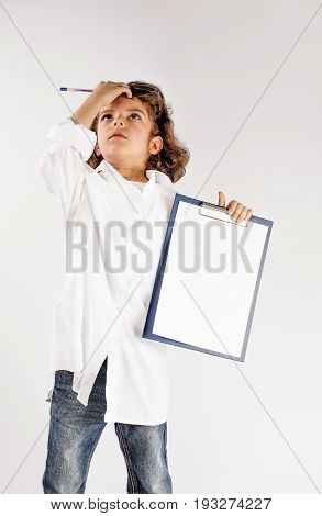 Little cute scientist clutched his head thoughtfully. Gray background.