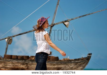 Young Girl And Boat
