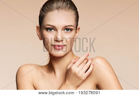 Image of beautiful young woman on beige background. Youth and skin care concept