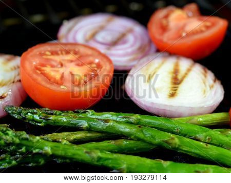 Tomato, Asparagus Spears and Red Onion Grilling on the BBQ.