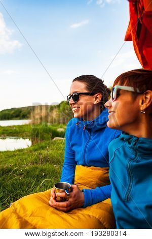 Two Girls Having Fun Near The Tent Camping..