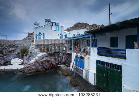 View of boat houses in Firopotamos fishing village on Milos island in Greece.