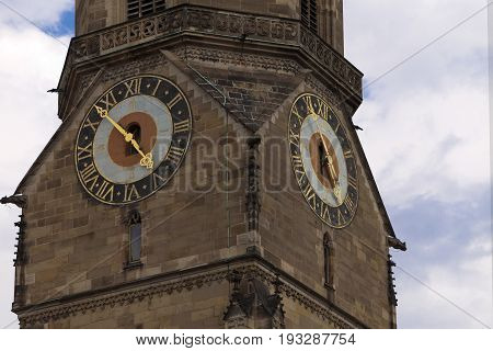 tower clock on Stiftskirche church bell tower in Stuttgart in Germany