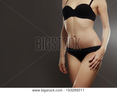 Beautiful Woman Show Her Tan Slim Body. Beautiful Slim Woman Body. Perfect Shining Skin For Summer.