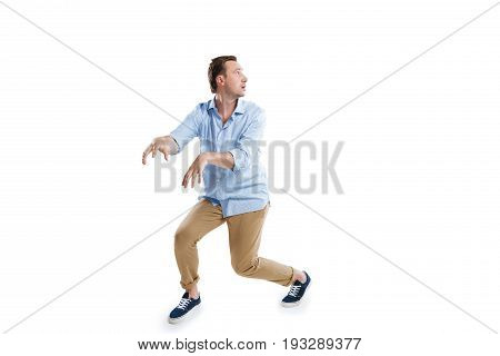 Young Scared Man Sneaking And Looking Away Isolated On White