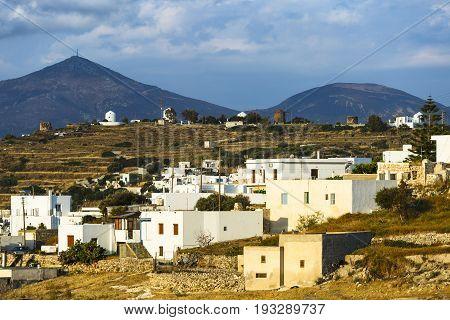 Triovasalos village and windmills on Milos island in Greece.