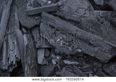 Black coal texture. Charcoal background. Burned wood
