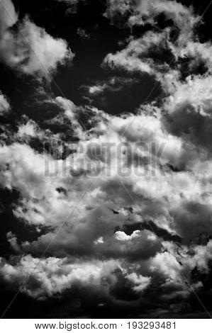Cloudscape background of black and white dramatic monochrome cumulus clouds