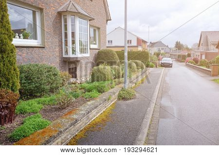 Beautiful street in silent suburb of European town