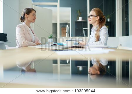 Employer listening to one of applicants in office