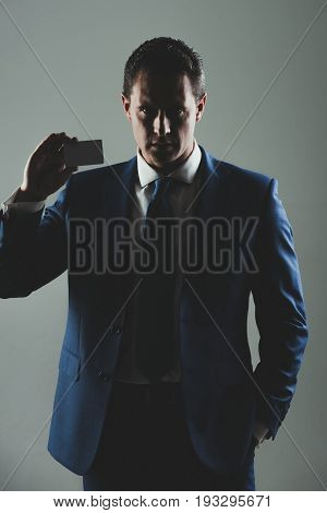 Man Holding Bank Or Business Card