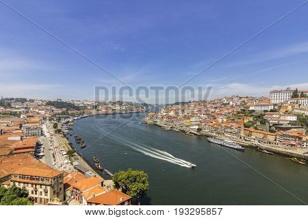 Panoramic view of old downtown Porto Ribeira cityscape and tradicional Rabelo boats on a summer day Portugal.
