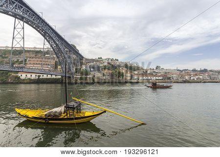 View of Ribeira historical quarter on the margin Douro river embankment Oporto old town and Luis I bridge Porto Portugal.