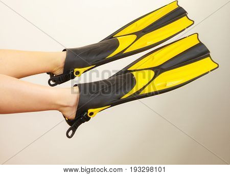 Woman Presenting Flippers Female Legs In Fins