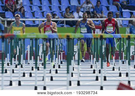 Rio de Janeiro Brazil - august 18 2016: Runner TAIWO Jeremy (USA) during Men´s Decathon (110m Hurdles) in the Rio 2016 Olympics Games