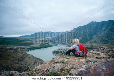 Beautiful Woman hiking outdoors with Backpack. Eco Tourism