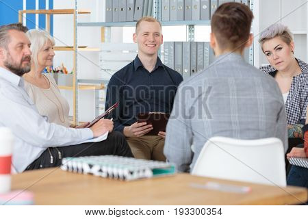 Group of coworkers immersed in a deep conversation