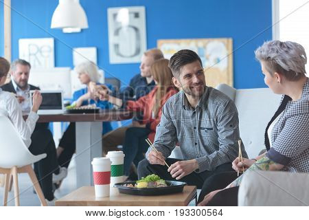 Staff of white collar workers having a lunch break in an office