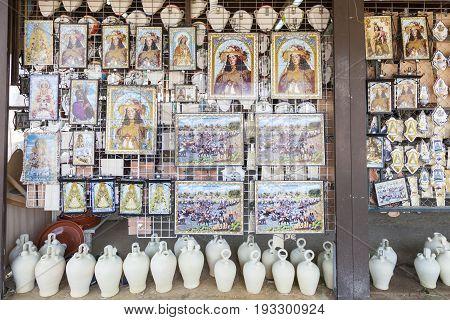 El Rocio Spain - June 2 2017: Icons of the Madonna of El Rocio for sale in a shop during the pilgrimage Romeria 2017. Province of Huelva Andalusia Spain
