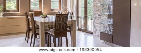 Beige and brown dining room in new house