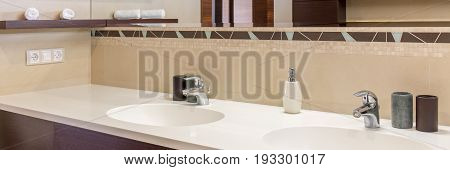 Close-up of two sinks in modern bathroom