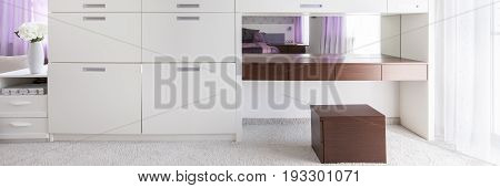 White and brown furniture in modern interior