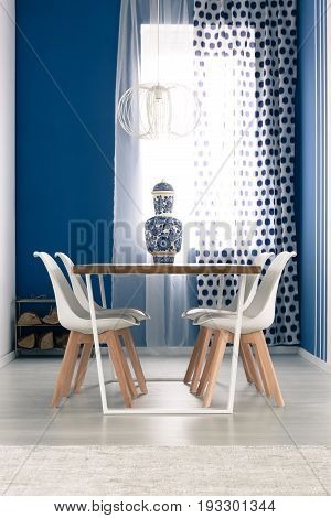 White and blue dining room with stylish furniture