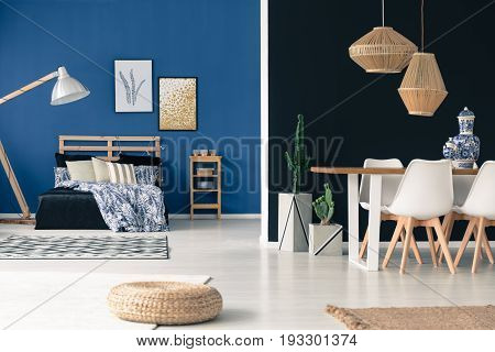 Wooden furniture in black and blue apartment