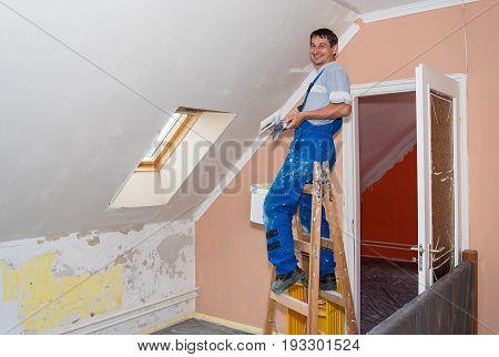 Happy Hands Plasterer At Work