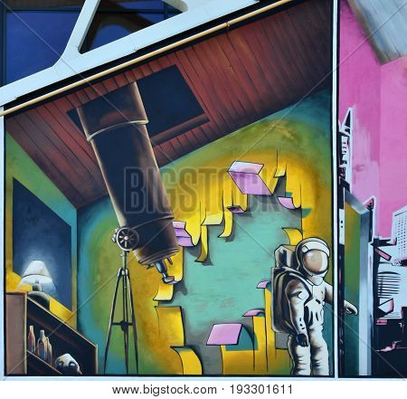 Detailed Image Of Color Graffiti Drawing. Background Street Art Background With A Painted Cosmonaut