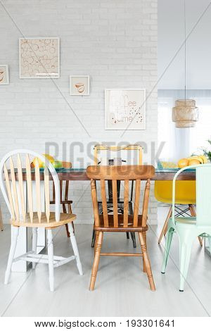 Dining space with upcycled wooden chairs and table in stylish fancy loft