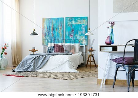 Stylish grey and purple bedclothes on the bed