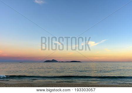 View of Cagarras islands at dusk in front off Ipanema beach in Rio de Janeiro