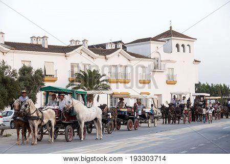El Rocio Spain - June 1 2017: Pilgrims in horse-drawn carriages in El Rocio during the pilgrimage Romeria 2017. Province of Huelva Almonte Andalusia Spain