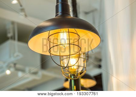 Tungsten lamp bulb old vintage design style cafe decoration.