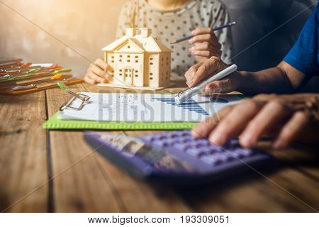 Woman Calculating House Tax Financial For Buy A New Home Budget Savings At Old Loft House With Old W