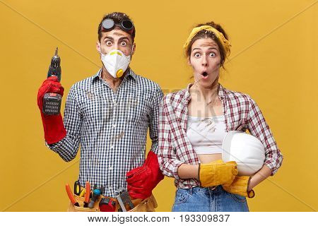 Young Service Workers Doing Maintenance: Male With Protective Mask, Eyewear, Gloves And Belt With To