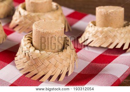 Pacoca - Brazilian Candy Of Ground Peanut With Wicker Hat Of Festivity Festa Junina Decoration.