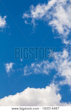 Bright blue sky and white clouds in clear weather appropriate for backgound