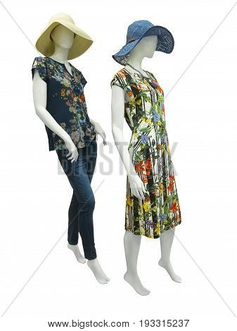 Two full-length female mannequins wear fashion clothing. Isolated on white background. No brand names or copyright objects.