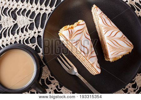 Pieces Of Estherhazy Cake And Coffee With Milk Close-up On The Table. Horizontal Top View