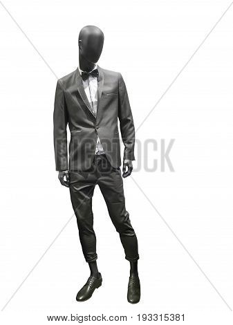 Full-length male mannequin dressed in gray suit isolated on white background. No brand names or copyright objects.