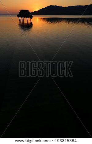 Lago Peten Itza - Overwater Hut and Sunset