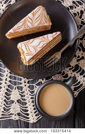 Pieces Of Estherhazy Cake And Coffee With Milk Close-up On The Table. Vertical Top View